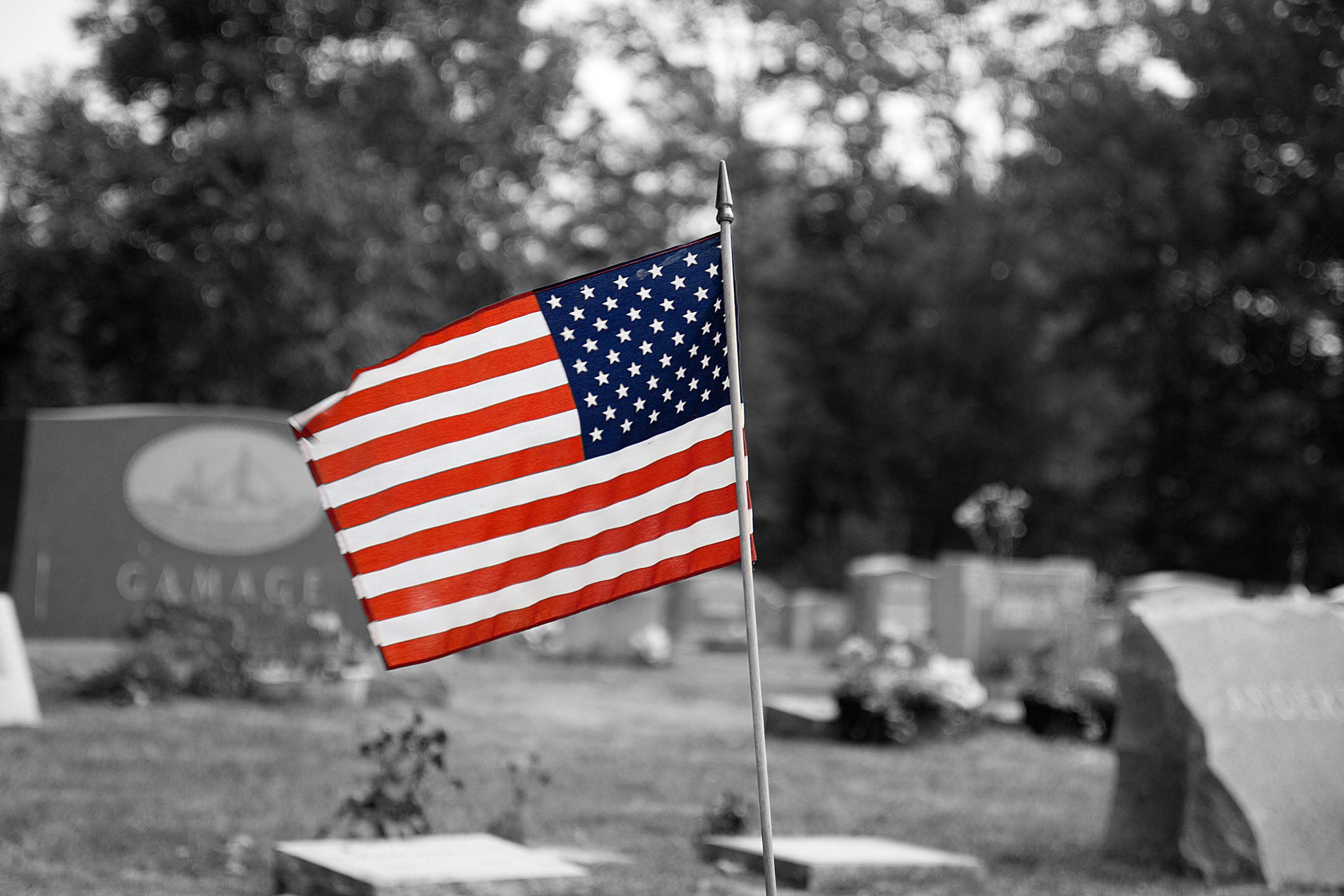 US Flag in a country cemetery – BW