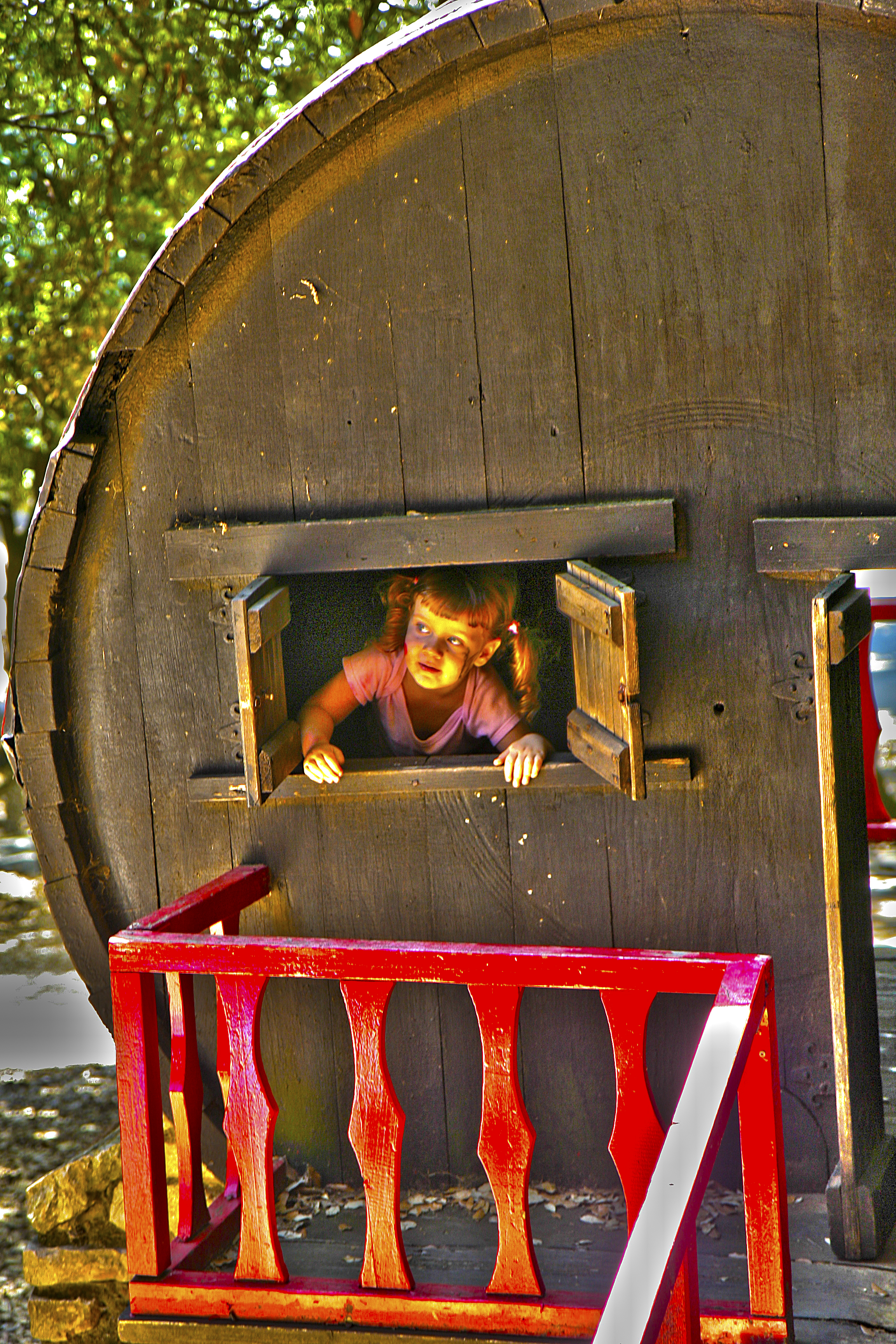 Elisa playing on a house-cask – HDR