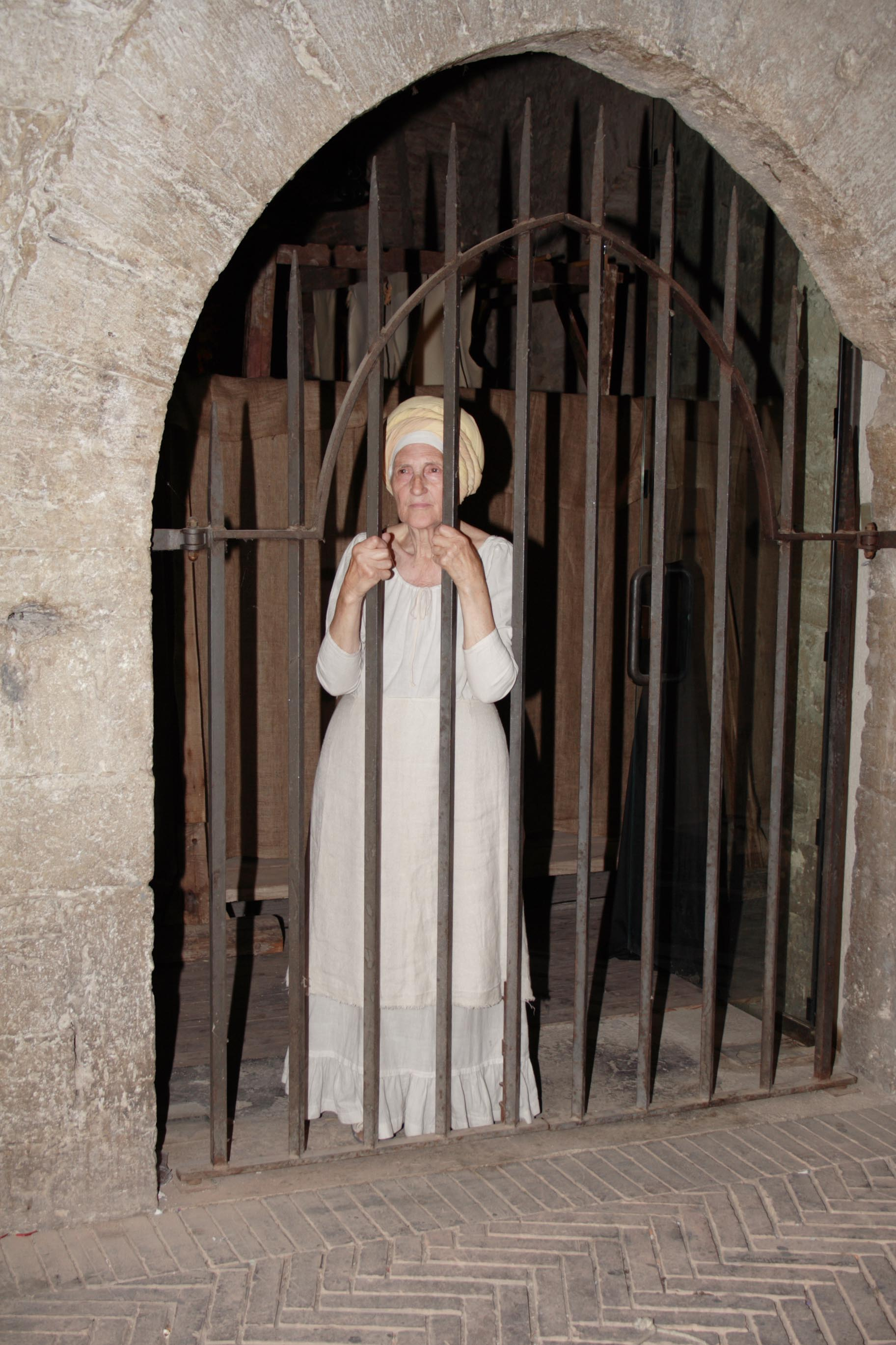 A medieval woman in jail